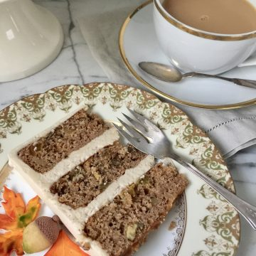 A slice of applesauce cake and cup of tea