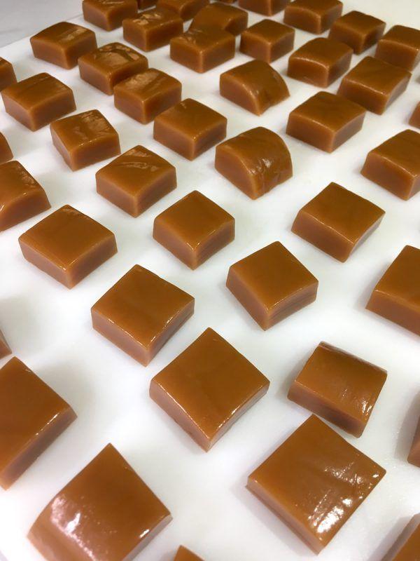Cut caramel squares on cutting board