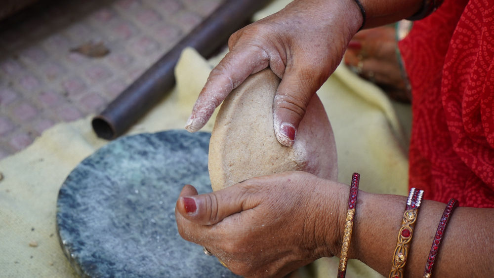 The task of making rotis is complex and demands labor