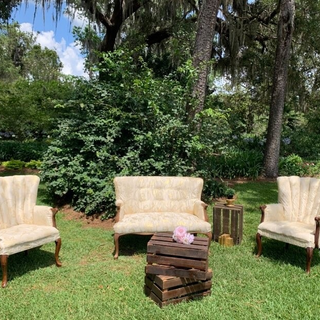 Ivory and gold chairs with wood arm rest and bottoms