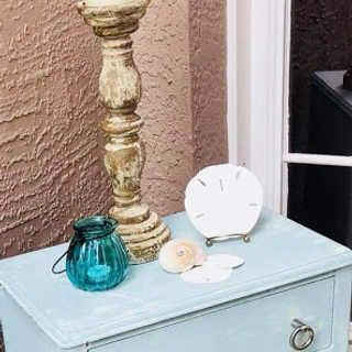 blue end table with silve hardware