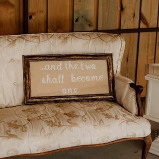 Gold floral pattern with wood arm rest and legs