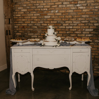 Antique white buffet with gold accents