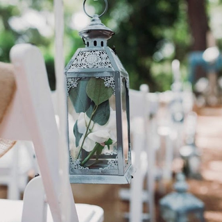 Small grey metal lanterns with glass
