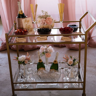 Gold cart with glass shelves.