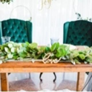Emerald green tuffed velvet high back chairs