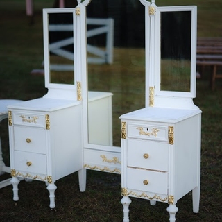 White vintage vanity with folding mirrors with gold accents