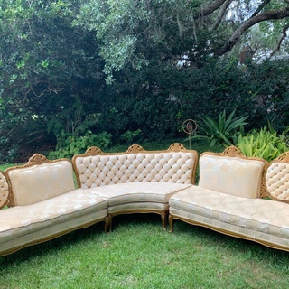 Ivory sectional with tuffed back and gold trim