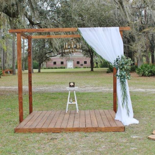 Stained pergola with floor. for florals and drapes