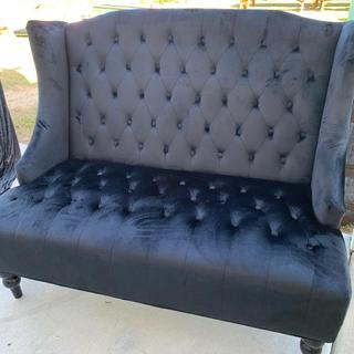 Black tuffed winged love seat