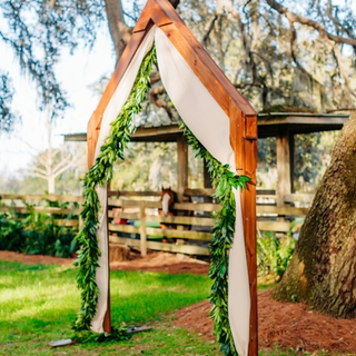 A-framed arch with drapes and florals