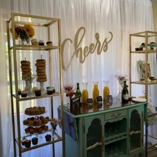 Gold display racks with glass shelves