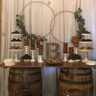 wood barn door topper with barrels as bases