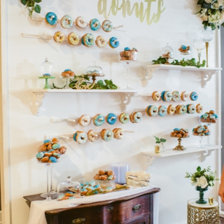 White wall with shelves and donut sticks