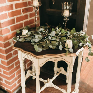 cream table with gold accents with a wood top