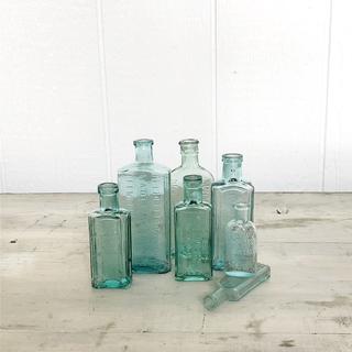small blue vintage glass bottles