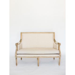 straight back linen settee with light wood trim and legs