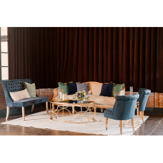 Linen sofa with blue loveseat, two blue chairs, and gold coffee and side tables.