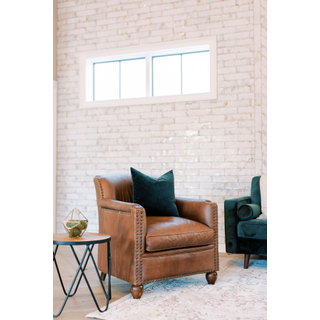 leather armchairs with green pillow
