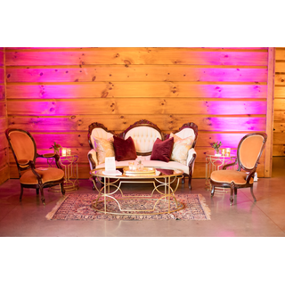 Vintage white couch, two orange chairs, gold tables