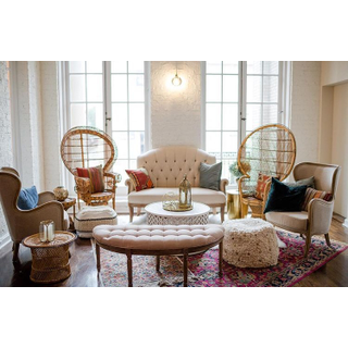 Linen settee, two linen chairs, two peacock chairs, linen bench, two floor poufs, and white coffee table