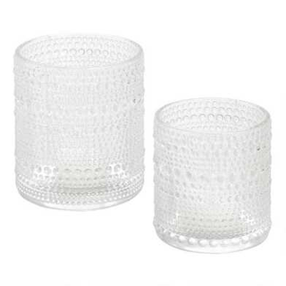 two dotted glass votives