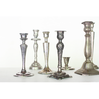 variety of silver candle holders