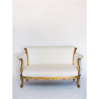 white settee with gold trim and legs