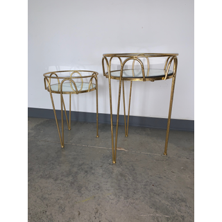 two gold side tables