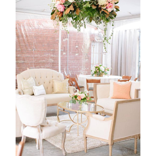 Three linen loveseats, two linen chairs, gold mirror coffee table
