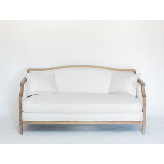 white sofa with wood trim and legs