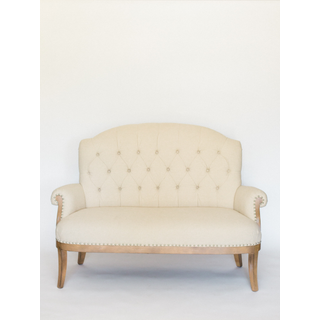 round back linen settee with wood legs