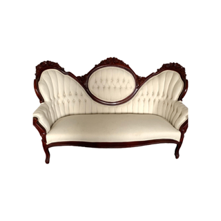 vintage white sofa with dark wood trim and legs
