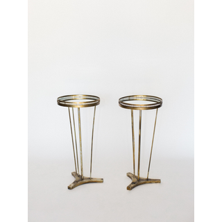 two tall gold round end tables