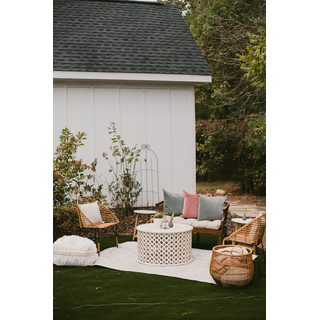 Small boho and rattan lounge in front of white house