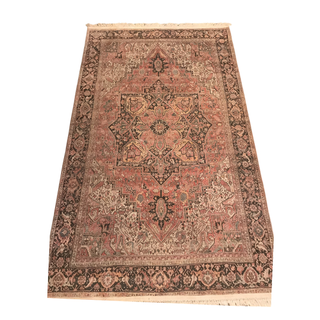 pink rug with white trim and brown detail
