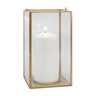 square gold lantern with candle