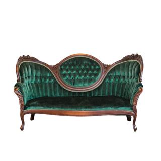 green velvet vintage sofa with dark wood trim and legs