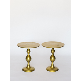 two gold end tables