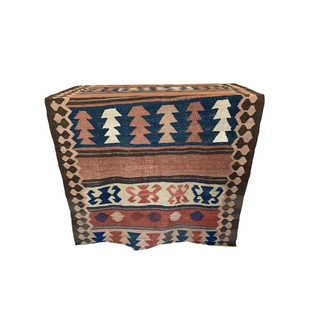brown vintage rug with pink and blue detail