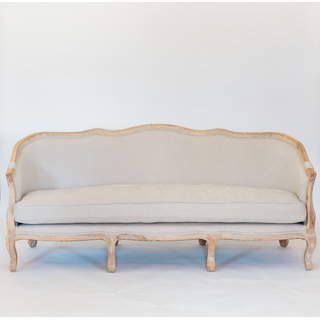 linen sofa with curved wood back and legs