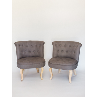 dark gray tufted chairs with wood legs