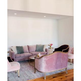 Purple sofas and chairs on purple rug