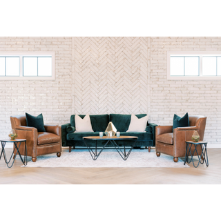 Green sofa, two leather chairs, black and wood tables