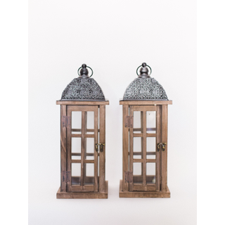 two wooden lanterns with silver tops