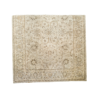 tan rug with brown and yellow detail