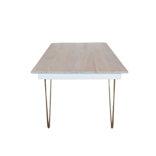 white table with gold legs