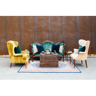 Vintage green sofa with vintage yellow and peach chair, with wood trunk