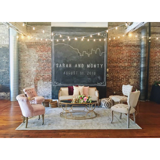 Linen sofa with two pink chairs, two linen chairs, gold coffee and side tables
