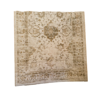 tan rug with brown and green detail